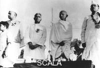 ******** Members of the Indian National Congress on the dais at Haripura, India, 1st March 1938. From left to right, Jamnalal Bajaj, Darbar Gopoldas Dasai, Mahatma Gandhi (Mohandas Karamchand Gandhi) and Subhas Chandra Bose.