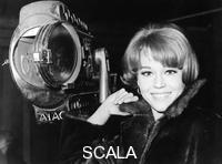 ******** Jane Fonda, American actress, film star and political activist. The daughter of Hollywood actor Henry Fonda, Jane Fonda became famous in the 1960s with her roles in 'Cat Ballou' and 'Barbarella', the latter establishing her as a sex symbol. In 1971 she won the Best Actress Oscar for her role in 'Klute', repeating the feat in 1978 for 'Coming Home'. She has been an active campaigner on a range of issues, including opposition to US involvement in the Vietnam War and the invasion of Iraq and feminist issues.