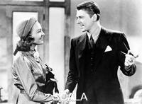 ******** Ronald Reagan and Susan Hayward in 'Girls on Probation', 1938.