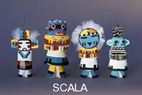 ******** Four minature Hopi kachina dolls are carved from cottonwood and are painted very colorful.