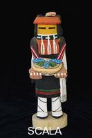 ******** Traditional Hopi corn maiden Katsina doll carved from a piece of cottonwood and then painted with colorful paints. The corn maiden is offering blue corn and prickly pear and shows a prosperous fall harvest.