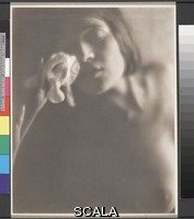 Weston, Edward (1886-1958) The White Iris. 1921. [Tina Modotti, nude bust portrait leaning toward iris]. Platinum or palladium print. Overall, Primary Support: 9 1/2 x 7 1/2 in. (24.1 x 19 cm) Overall, Secondary Support: 17 15/16 x 14 in. (45.6 x 35.6 cm) Image: 9 1/2 x 7 1/2 in. (24.1 x 19 cm). Johan Hagemeyer Collection/Purchase. Inv. N.: 76.5.27